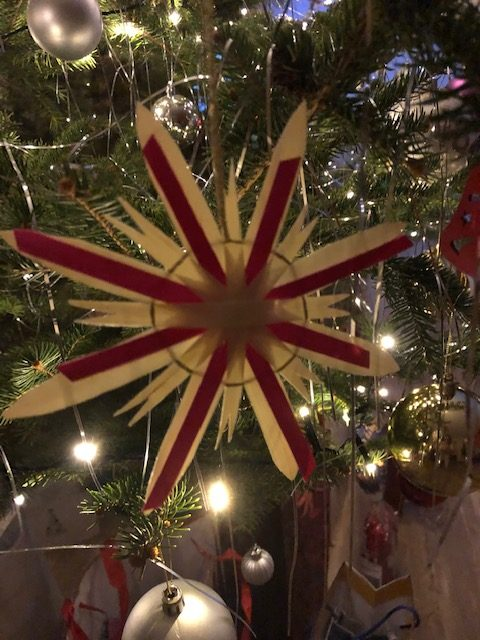 Straw star Christmas ornament with gold thread and red stripes
