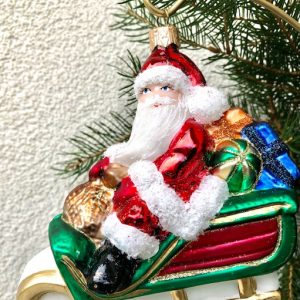 Santa on sleigh with gifts